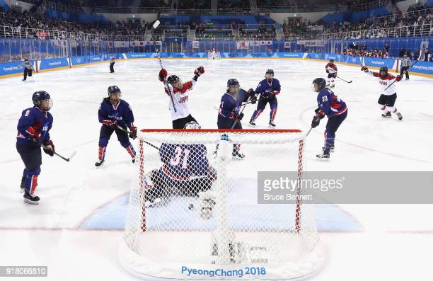 Hanae Kubo of Japan celebrates after a goal scored against Korea in the first period during the Women's Ice Hockey Preliminary Round Group B game...