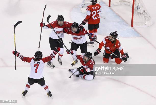 Hanae Kubo of Japan celebrates with teammates after scoring a goal in the third period against Switzerland during the Women's Ice Hockey Preliminary...