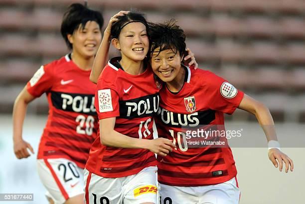 Hanae Shibata of Urawa Red Diamonds celebrates scoring her team's first goal with her team mate Chinatsu Kira during the Nadeshiko League match...
