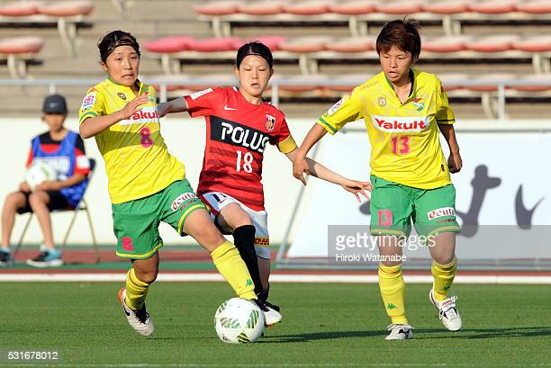 Hanae Shibata of Urawa Red Diamonds competes for the ball against Yuka Anzai and Kozue Setoguchi of JEF United Chiba during the Nadeshiko League...