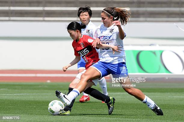 Hanae Shibata of Urawa Red Diamonds Ladies and Lauren Bohaboy of Iga FC Kunoichi compete for the ball during the Nadeshiko League match between Urawa...
