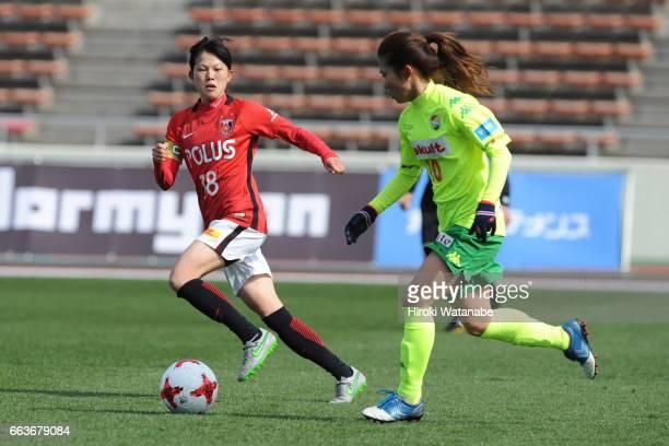 Hanae Shibata of Urawa Red Diamonds Ladies and Risa Fukasawa of JEF United Chiba Ladies compete for the ball during the Nadeshiko League match...