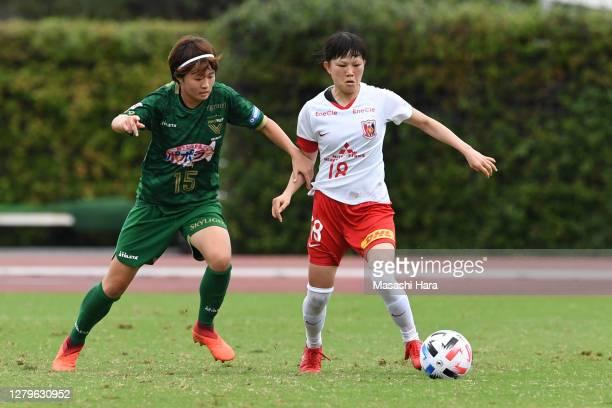 Hanae Shibata of Urawa Reds Ladies and Hinata Miyazawa of NTV Beleza compete for the ball during the Nadeshiko League match between Nippon TV Tokyo...