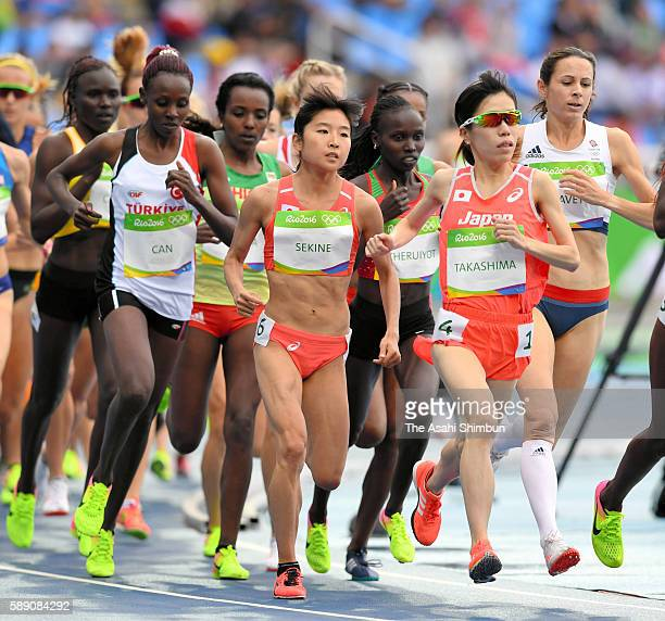Hanami Sekine and Yuka Takashima of Japan compete in the Women's 10000 metres final on Day 7 of the Rio 2016 Olympic Games at the Olympic Stadium on...