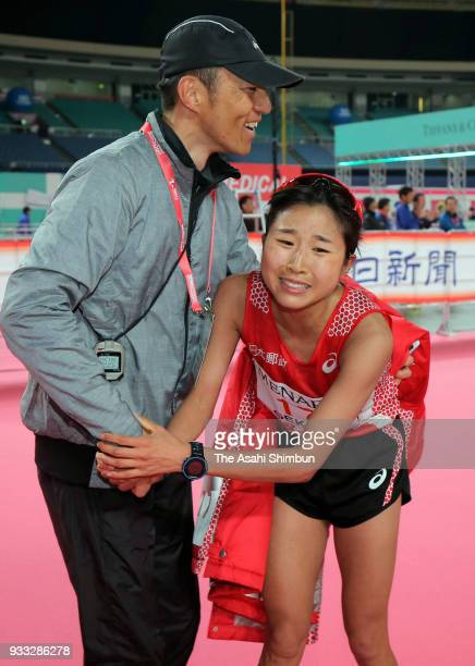 Hanami Sekine of Japan celebrates her third finish with her coach Masahiko Takahashi after the Nagoya Women's Marathon 2018 at Nagoya Dome on March...