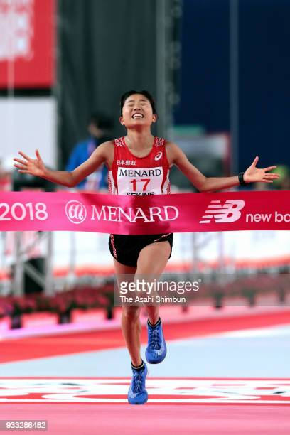 Hanami Sekine of Japan crosses the finish line during the Nagoya Women's Marathon 2018 at Nagoya Dome on March 11 2018 in Nagoya Aichi Japan