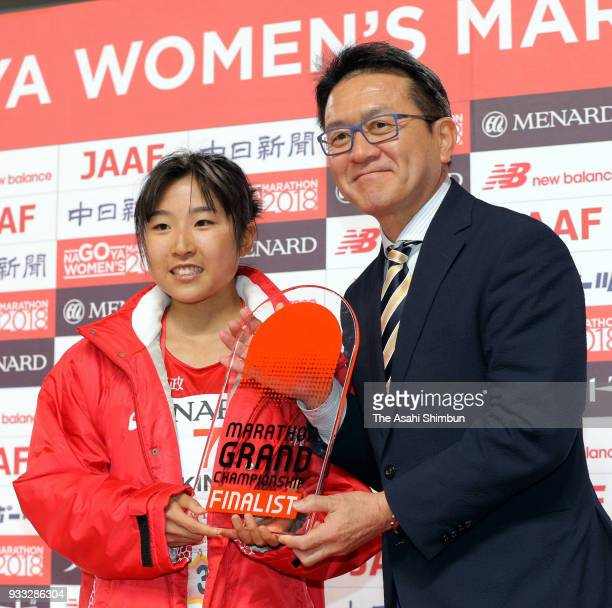 Hanami Sekine of Japan is congratulated by Toshihiko Seko after her third finish after the Nagoya Women's Marathon 2018 at Nagoya Dome on March 11...
