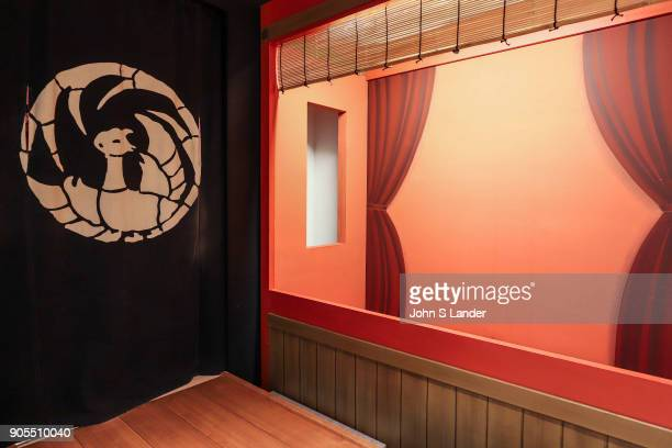 A hanamichi is a passagway used in kabuki theater and runs through the theater At the end of the aisle hangs an agemako curtain from which actors...