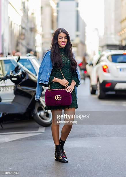 Hanan Tariki wearing a velvet Gucci bag denim jacket Gucci boots and a green dress on September 27 2016 in Paris France