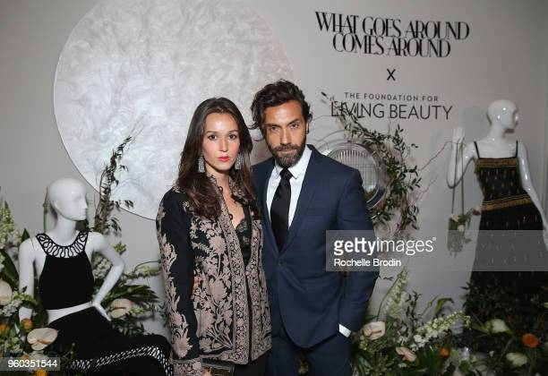 Hanane Thompson and Marc Ange attend The Foundation for Living Beauty Dinner Under the Stars on May 19 2018 in Beverly Hills California