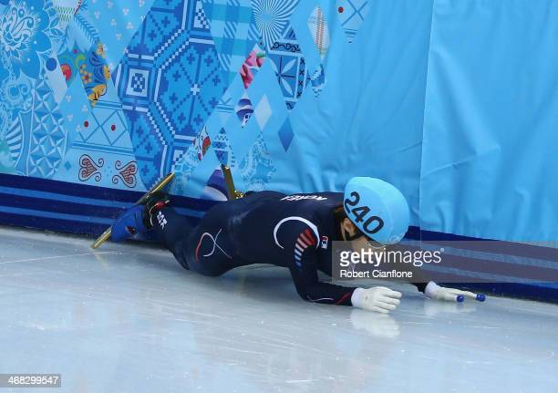 HanBin Lee of South Korea crashes out of the the Short Track Speed Skating Men's 1500m semifinal after colliding with Da Woon Sin of South Korea...