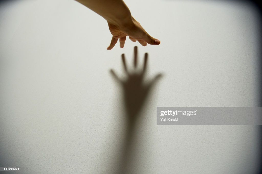 Hand against the Wall : Stock Photo