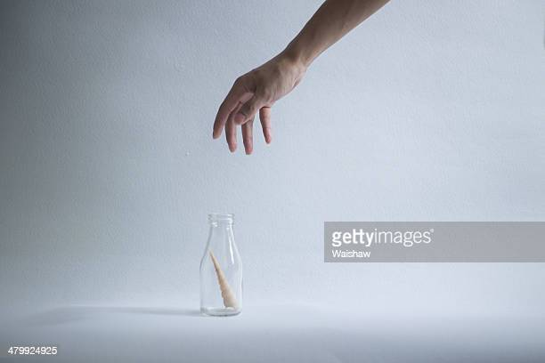 Hand an bottle