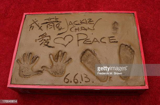 hand and foot imprints made by actor Jackie Chan during the Jackie Chan Hand and Foot Print Ceremony at the TCL Chinese Theatre on June 6 2013 in...