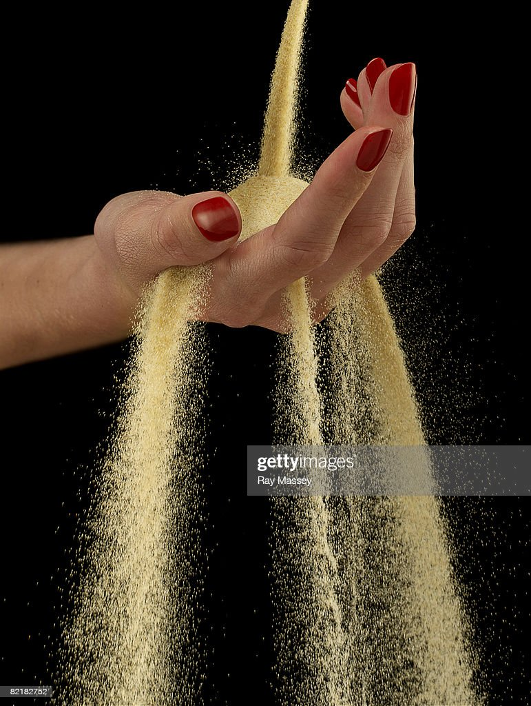 Hand and sand : Stock Photo