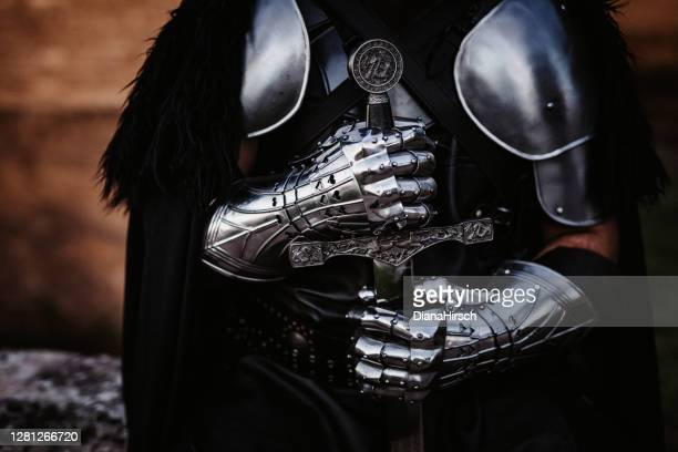 hand and sword of a medieval fantasy knight - sword stock pictures, royalty-free photos & images