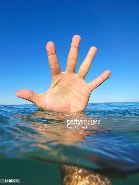 Hand and water