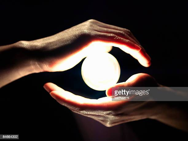 A hand around light