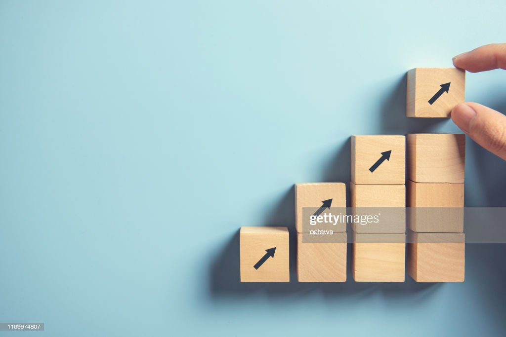 Hand arranging wood block stacking as step stair on paper pink background. Business concept growth success process, copy space. : Stock Photo