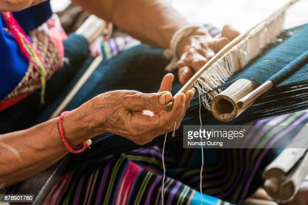 hand at work with fabric weaver - bangladeshi woman stock photos and pictures