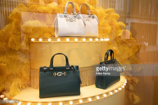 Hand bags in exclusive clothes shop window for Gucci on New Bond Street in Mayfair, London, England, United Kingdom. Bond Street is one of the...