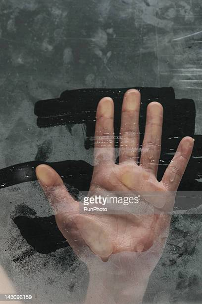 hand behind glass,close-up