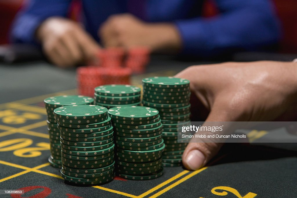 Hand betting gambling chips : Stock Photo