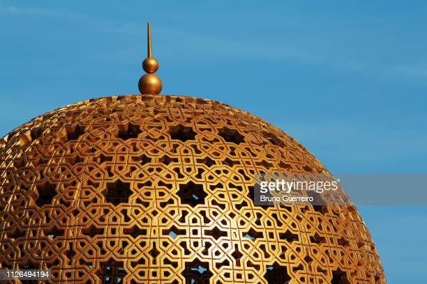 hand carved golden dome against blue sky - dome stock pictures, royalty-free photos & images
