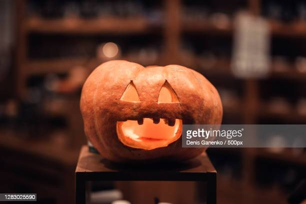 hand carved pumpkin indoors,russia - ugly face stock pictures, royalty-free photos & images