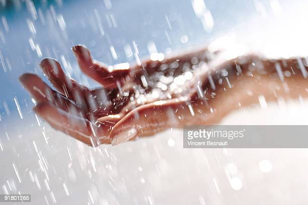 hand catching rain - catching stock pictures, royalty-free photos & images