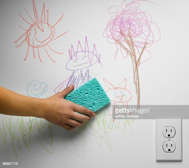 Hand cleaning off child's drawing