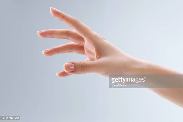 hand close-up - つかまえる ストックフォトと画像