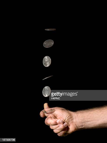 hand coin toss silver dollar - flipping a coin stock pictures, royalty-free photos & images