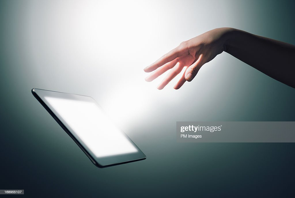 Hand commanding digital tablet : Stock Photo