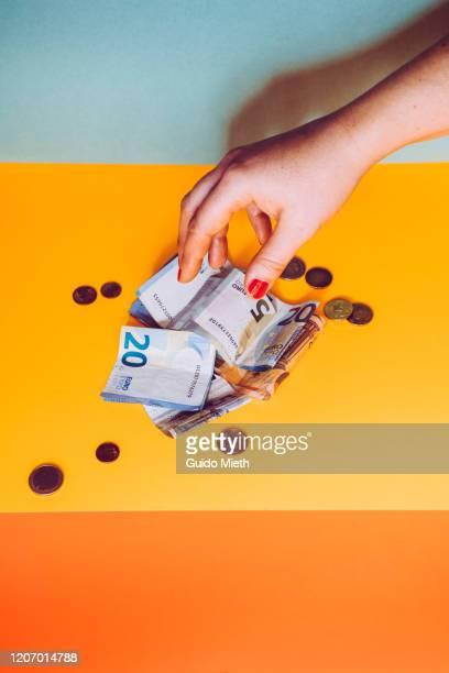 hand counting savings . - geld stock-fotos und bilder