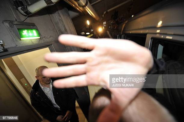A hand covers the camera while a photographer tries to shoot pictures of injured and operated British AC Milan footballer David Beckham as he is...