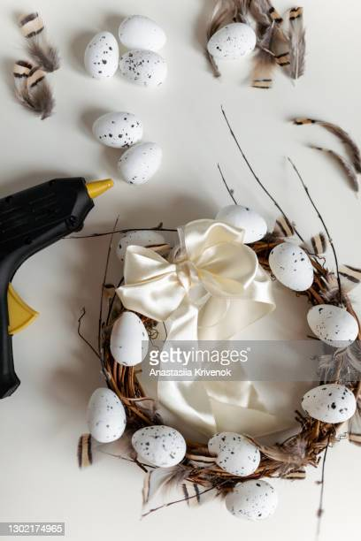 hand crafted easter wreath on white background and tools. - easter decoration ストックフォトと画像