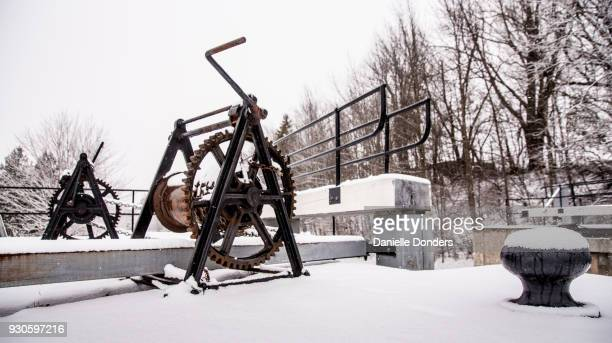 Hand crank at the side of the Rideau Canal at Long Island Locks in winter