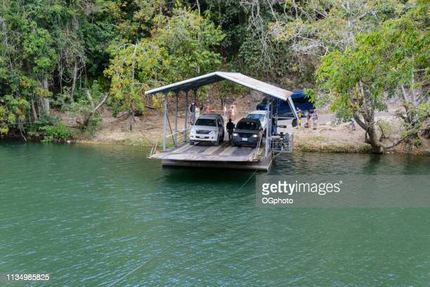 hand crank ferry crossing the mopan river, belize - ogphoto stock photos and pictures