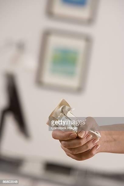 Hand crushing box of cigarettes