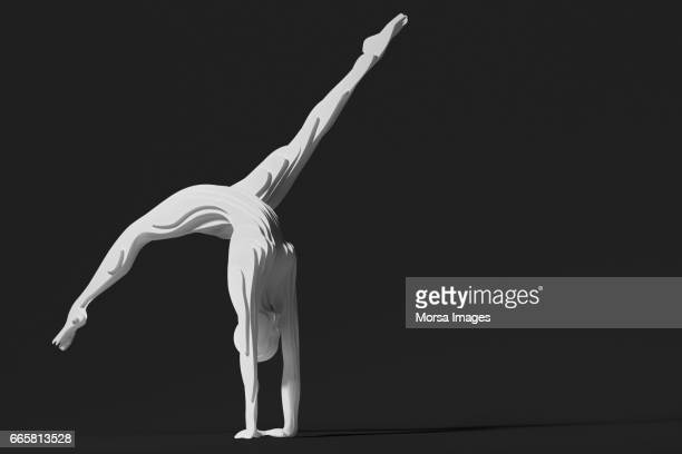 hand cut paper figure of a gymnast - acrobatic activity stock photos and pictures