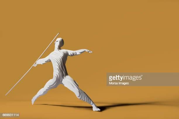 Corte de la mano figura de papel de un lanzador de jabalina
