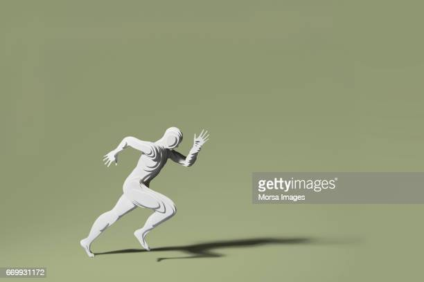 Hand cut paper figure of a runner