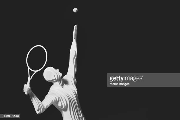 Hand cut paper figure of a tennis player