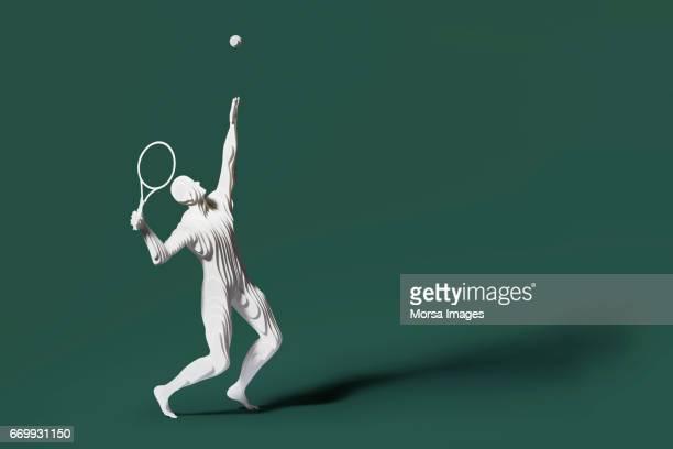 Corte de la mano figura de papel de un jugador de tenis