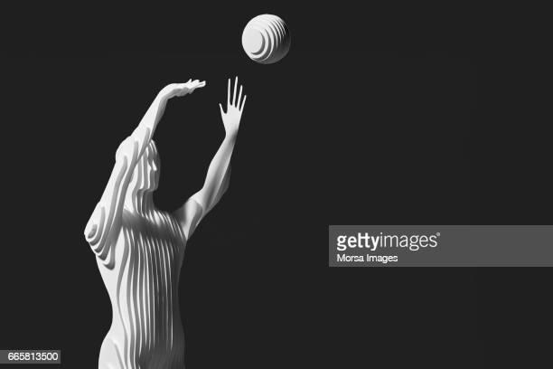 Corte de la mano figura de papel de jugador de baketball