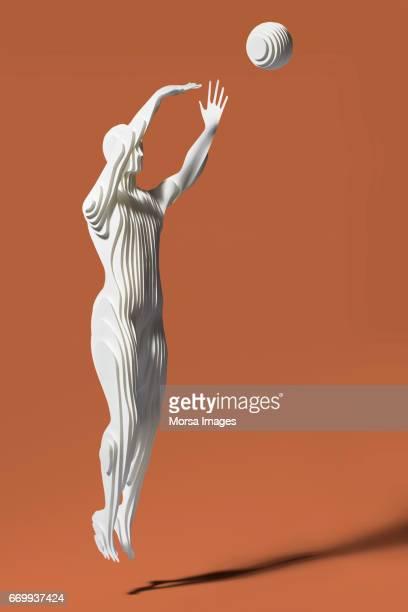 Hand cut paper figure of baketball player
