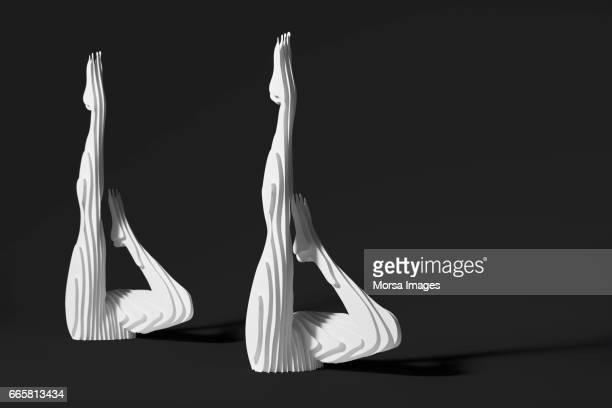 Corte de la mano figura de papel de nadadores sincronizados