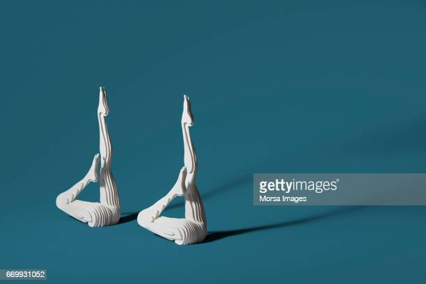 hand cut paper figure of synchronized swimmers - artistic swimming stock pictures, royalty-free photos & images