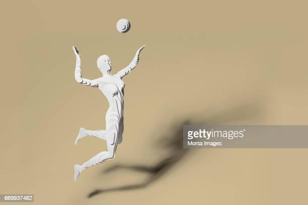 Corte de la mano figura de papel de jugadora de voleibol